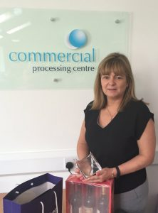 CPC Director Julie Griggs with the Broker of the Month award
